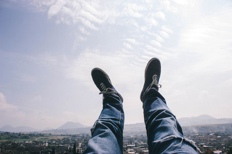 Adult Blue Cloud - Sky Day Fantasy Feet First Person View Flying Human Leg Jeans Low Section Mountains On Top One Person Outdoors People Personal Perspective Perspective Shoe Shoes Sky Sky And Clouds Upside Down Live For The Story