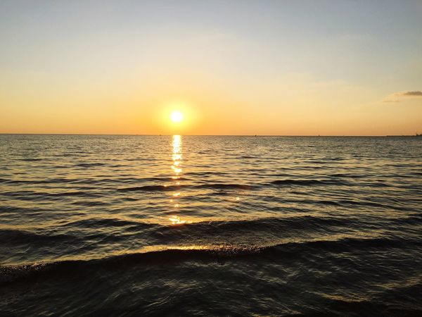Sunset Sea Scenics Sun Beauty In Nature Nature Tranquil Scene Water Horizon Over Water Tranquility Idyllic Sunlight Orange Color Beach No People Reflection Outdoors Rippled Silhouette