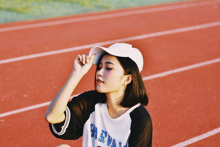 Young woman relaxing on running track