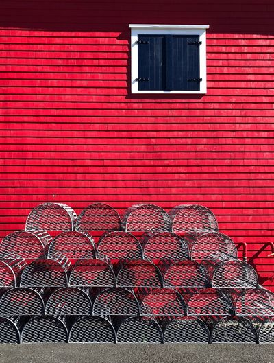 Closed window on red wall of building