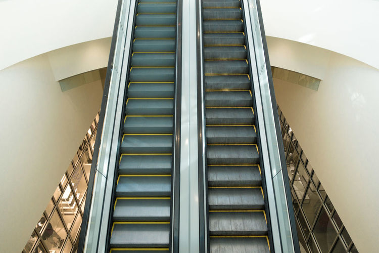 Architecture Built Structure Day Escalator Hand Rail Indoors  Low Angle View Minimal Mirrored Image Modern No People Staircase Steps Steps And Staircases