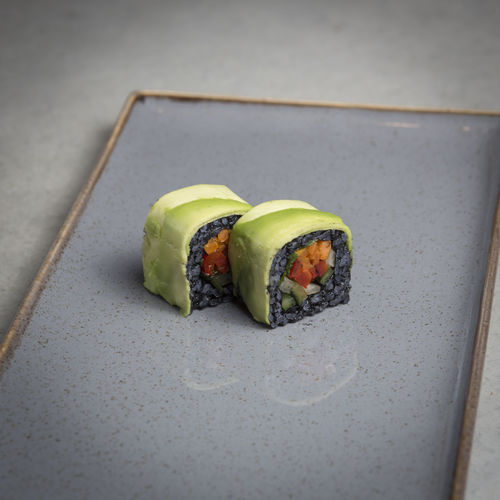 Close-up of sushi in plate on floor