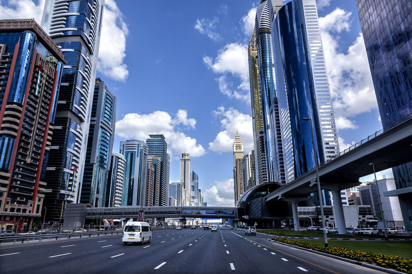 Dubai - Sheikh Zayed Road 01 Arquitecture Dubai Low Angle View Modern Blue Sky Bridge - Man Made Structure Building Exterior Business Finance And Industry Cityscape Cloud - Sky Contemporary Architecture Fish Eye Lens Modern No People Outdoors Road Sheikh Zayed Road Skyscraper The Way Forward Tourism Tourist Attractions Travel Destinations Visitdubai