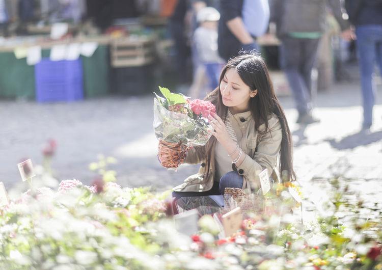 Woman holding flowering plants