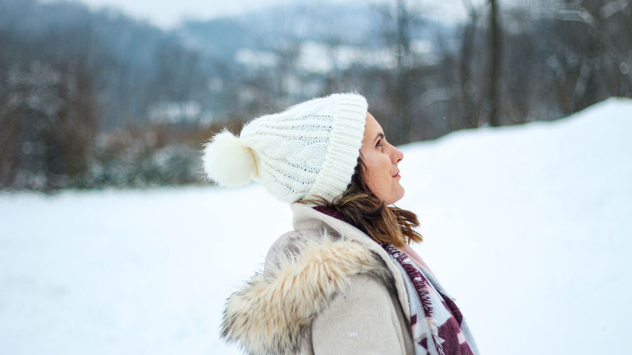 Portrait of woman with ice cream in snow