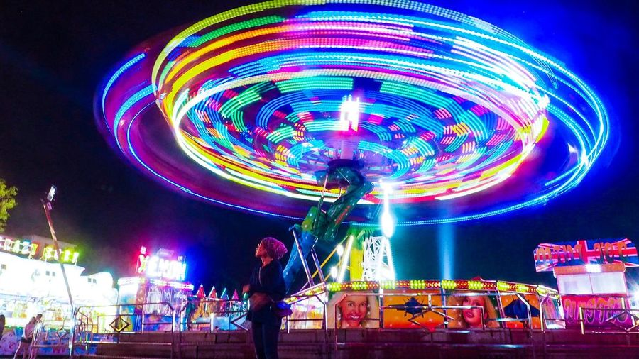 Night in funfair Amusement Park Night Amusement Park Ride Arts Culture And Entertainment Multi Colored Architecture Spinning Long Exposure Glowing Motion First Eyeem Photo EyeEmNewHere