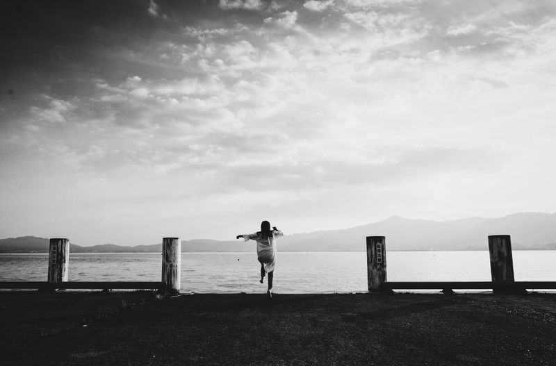 monochrome photography Monochrome Water Sea Sky Beach Land Real People Nature Beauty In Nature Scenics - Nature Horizon Over Water Lifestyles Horizon Standing Leisure Activity Cloud - Sky Tranquil Scene Full Length Day Tranquility Outdoors