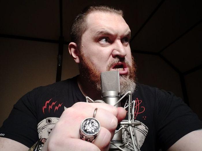 Portrait of man holding camera