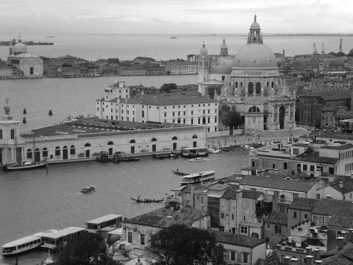 High angle view of grand canal by santa maria della salute in city