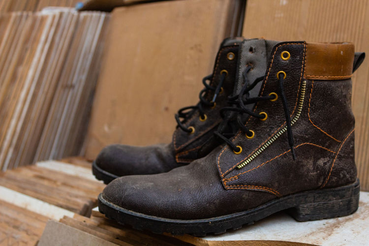Shoe No People Still Life Shoelace Close-up Pair Black Color Indoors  Boot Focus On Foreground Wood - Material Leather Old Day Personal Accessory Selective Focus Brown Clothing Flooring Compatibility Lace - Fastener Flat Shoe Menswear