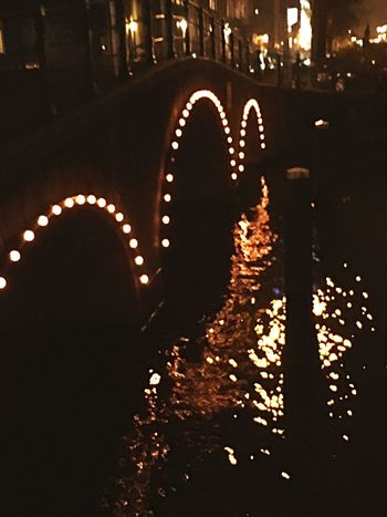 Reflections on a Bridge in Amstel Amsterdam Night Illuminated Architecture City Arts Culture And Entertainment No People Built Structure Outdoors Amsterdam Vibe Amsterdam Canal Water Places To Visit