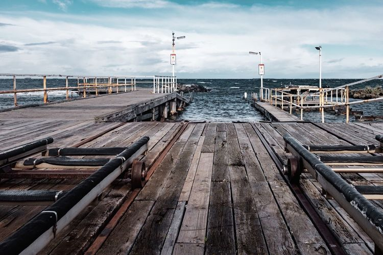 Wood - Material Pier Sky Cloud - Sky Water Jetty No People Wood Paneling Nature Sea Day Outdoors Scenics Tranquility Landscape Nautical Vessel Beauty In Nature The Week On EyeEm