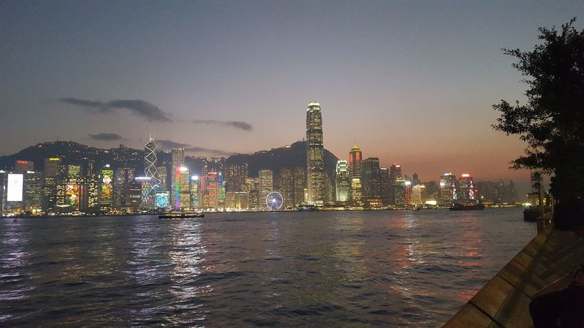 Hong Kong Central viewed from Kowloon across Victoria Harbor at Christmas time. Architecture Building Exterior Christmas City Cityscape Downtown District Financial District  Hong Kong Illuminated Light Show Modern Night No People Outdoors Reflection Sky Skyscraper Urban Skyline Victoria Harbor Water