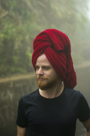 Man With Hair Wrapped In Towel Looking Away