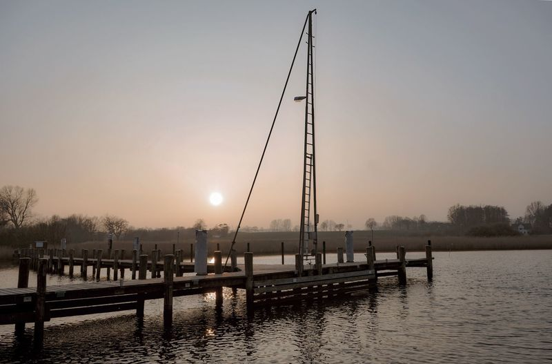 Die Schlei im März Water Sky Sunset Nature Architecture Built Structure Pier Waterfront Beauty In Nature Sun Outdoors Clear Sky No People