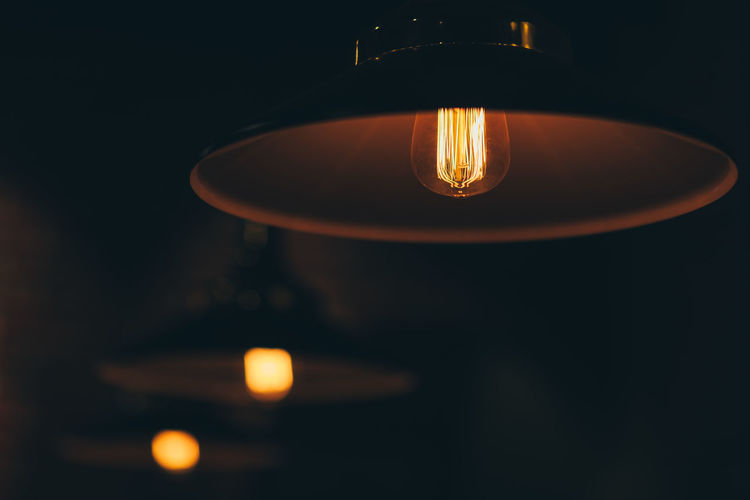 Bulb Illuminated Lighting Equipment Indoors  No People Dark Light Bulb Light Electricity  Close-up Glowing Light - Natural Phenomenon Electric Light Darkroom Electric Lamp Domestic Room Night Focus On Foreground Burning Filament Low Angle View