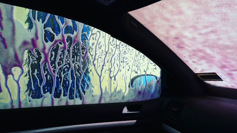 Pink car wash event EyeEmNew Street Photography Awards Pixelated Close-up Architecture Car Wash Windshield Side-view Mirror Car Interior Vehicle Interior Car Point Of View Steering Wheel