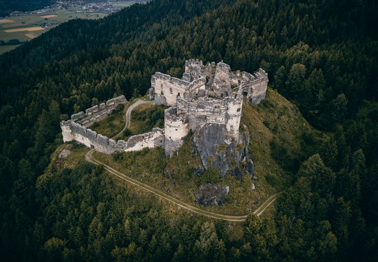 Old castle in the forest in austria aerial drone photo Tree Plant Mountain Scenics - Nature High Angle View Beauty In Nature Nature Tranquil Scene Tranquility Forest Architecture No People Non-urban Scene Land Green Color Environment Foliage Lush Foliage Travel Destinations History Outdoors WoodLand Old Castle