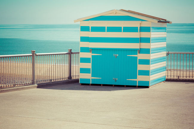 Beach garage painted in contrasting colours Beach Blue Building Exterior Built Structure Composed Contrasting Colors Garage Horizon Over Water Love Melancholy Memotries Outdoors Railing Scenics Sea Shed Shore Sky Sweet Tranquil Scene Tranquility Vacations Water