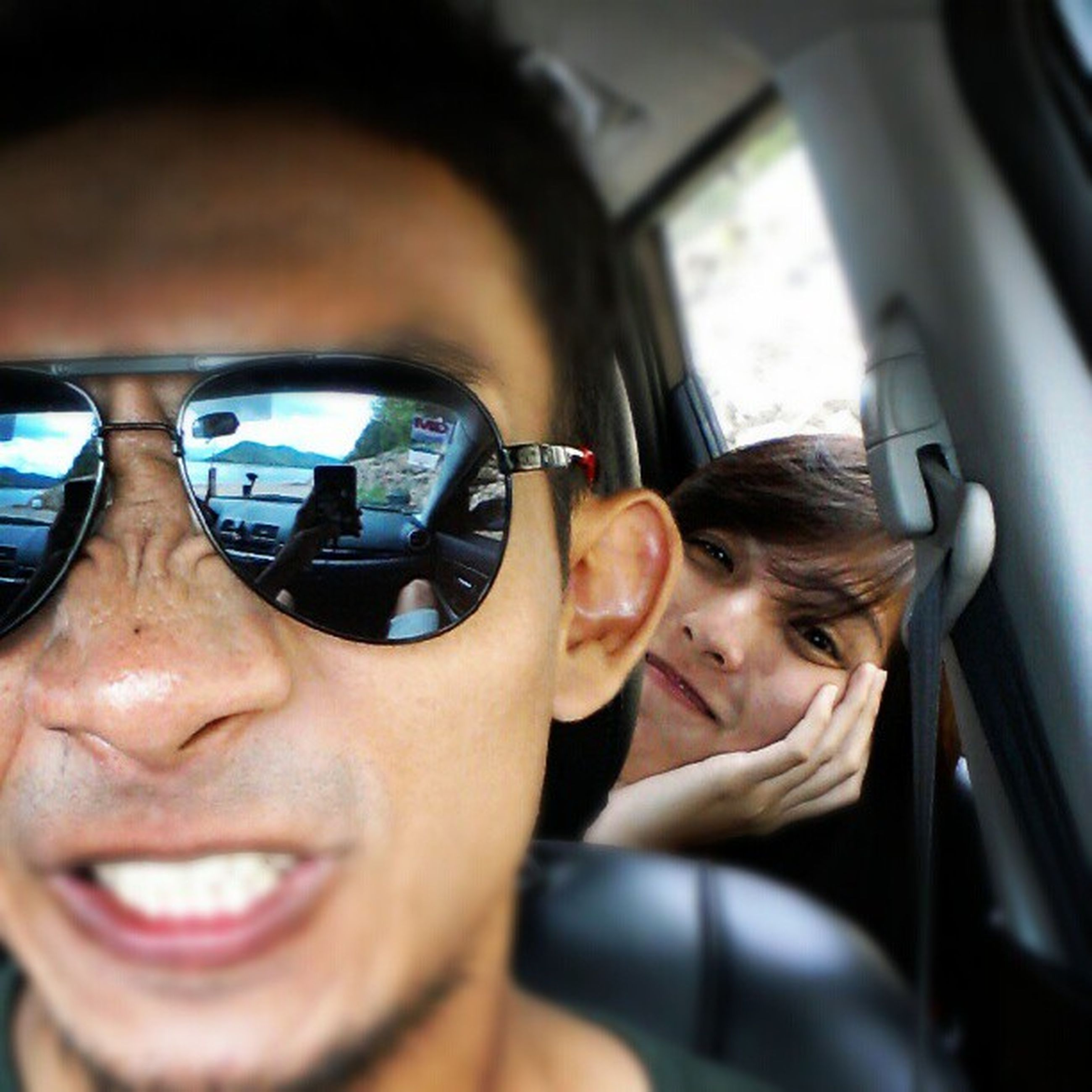 person, lifestyles, headshot, leisure activity, young adult, transportation, vehicle interior, looking at camera, mode of transport, portrait, young men, smiling, car, land vehicle, head and shoulders, sunglasses, front view, mid adult