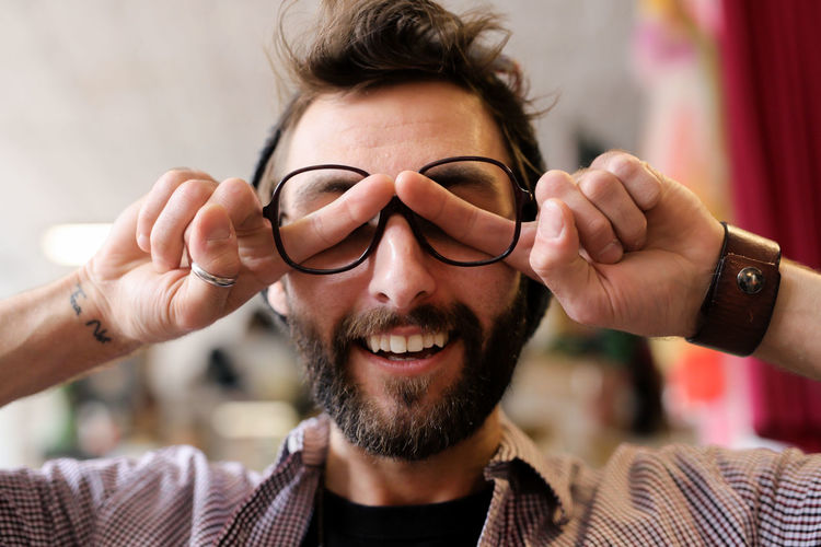 Adult Adults Only Beard Bracelet Close-up Comical Eyeglasses  Eyewear Happiness Hipster - Person Horn Rimmed Glasses Indoors  Men Messy Hair One Man Only Only Men St Louis Missouri Vintage Clothing Vintage Clothing Store Vintage Style Young Adult