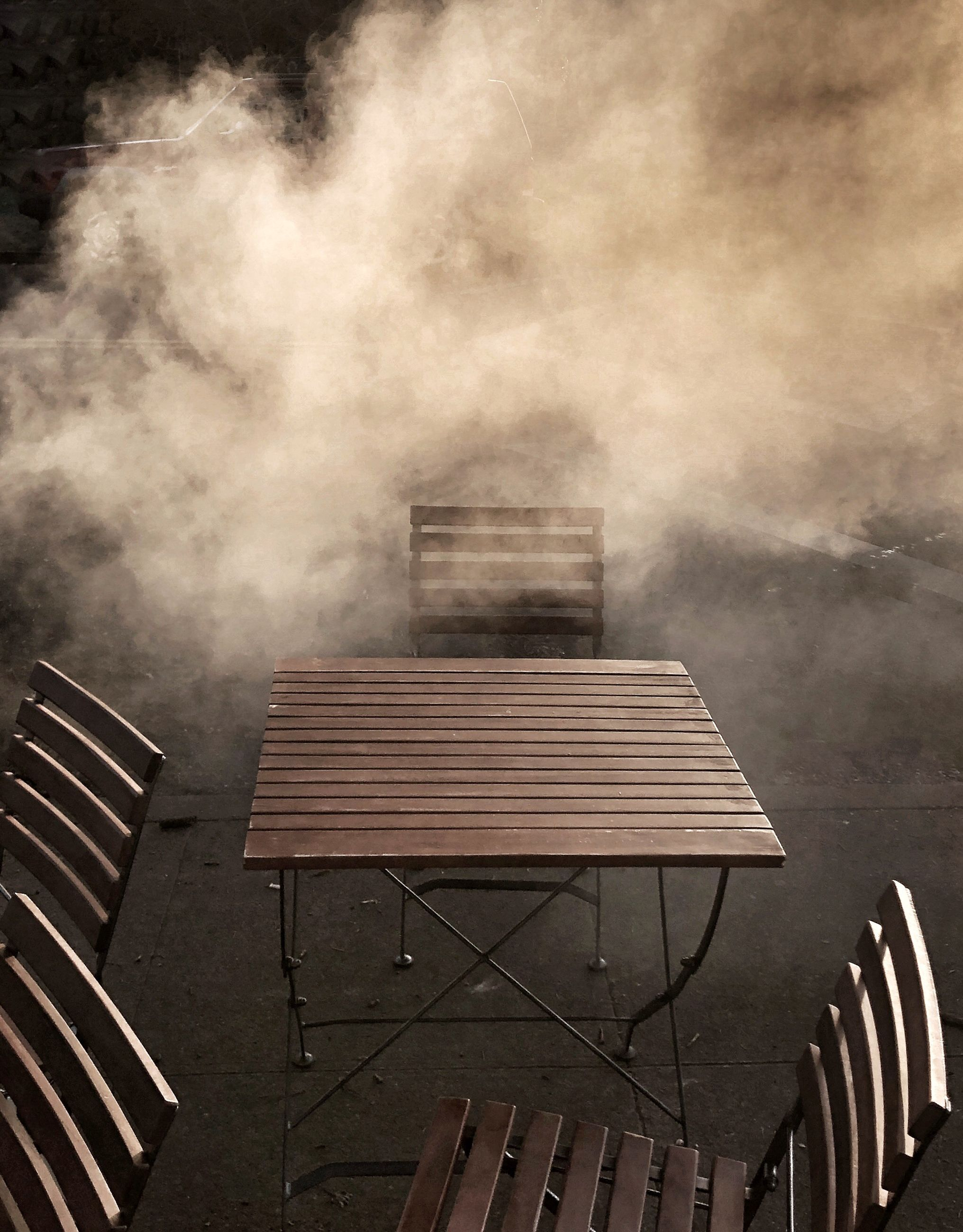 architecture, built structure, smoke - physical structure, building exterior, nature, no people, outdoors, day, roof, building, seat, sky, railing, low angle view, wood - material, striped, fog, pattern, heat - temperature, pollution