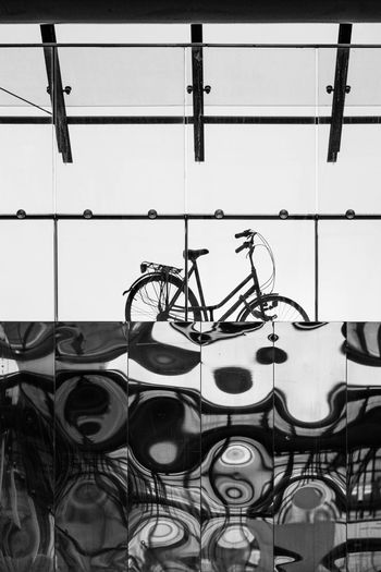 LantarenVenster Rotterdam Bike Bnw Bnw_architecture Bnwarchitecture Glass Metal Metro Reflection Sun No People Wall - Building Feature Built Structure Indoors  Day Pattern Architecture Glass - Material Creativity Window Bicycle Transparent Art And Craft Design Nature Land Vehicle Shadow Fujifilm Fuji