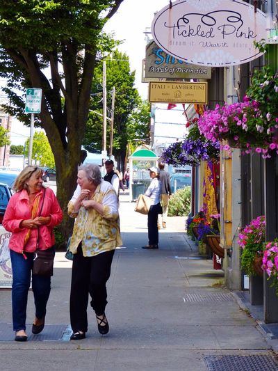 Port Townsend Older Woman Laughter Laughter Is The BEST Medicine Laughing Streetphotography Street Photography Flower Basket Friendship Shopping Enjoying Life Street View Feel The Journey Showcase June