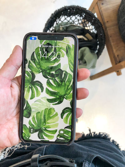 Tropical Human Hand Mobile Phone Portable Information Device Green Color Smart Phone Wireless Technology IPhoneography Photography Using Mobile Monstera Tropical Vibes Screenshot Screensaver