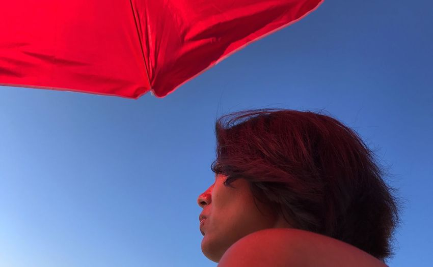 Lady in red. Headshot One Person Portrait Red Sky Women Blue Side View Adult Real People Outdoors Clear Sky The Portraitist - 2018 EyeEm Awards The Photojournalist - 2018 EyeEm Awards