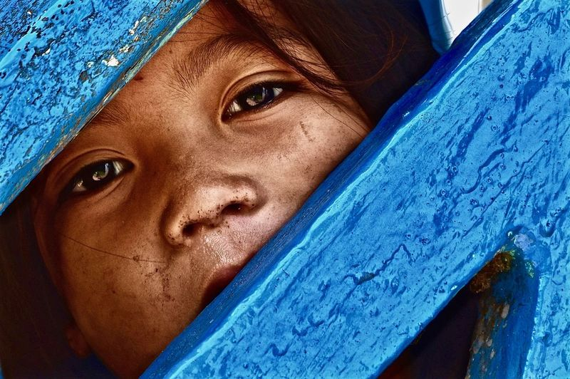 Cambodian Girl Child Portrait Nikon Travel Blue Cambodian Child Close-up Day Girl Human Eye Looking At Camera Nikonphotography One Person Outdoors People Portrait Street Street Photography Streetphotography The Portraitist - 2018 EyeEm Awards My Best Photo
