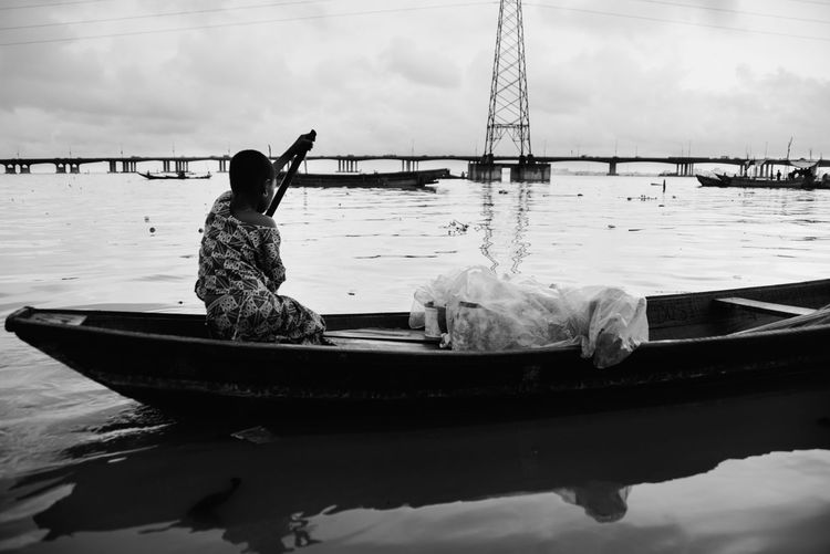 TheWeekOnEyeEM Africa Cloud - Sky Day Fisherman Lifestyles Mode Of Transportation Moored Nature Nautical Vessel One Person Outdoors Real People Sea Sitting Sky Transportation Travel Water Waterfront Women