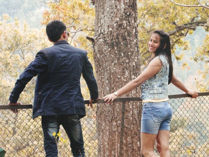 Lovely couple posing against railing.... 😘 ImPHOTO Imphotography Imphotographer ImPrashant Rocky Mountains Sikkimdiaries Sikkimtourism Sikkim Love ♥ Attitude Smile❤ Togetherness Two People Love Happiness Bonding Day Tree Leisure Activity Casual Clothing Fun People Autumn Lifestyles Standing Real People Couple - Relationship Outdoors Smiling An Eye For Travel Adventures In The City The Fashion Photographer - 2018 EyeEm Awards The Traveler - 2018 EyeEm Awards A New Beginning This Is Natural Beauty