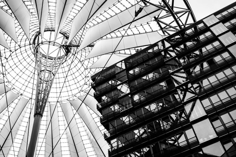 Low Angle View Of Sony Center Against Sky In City
