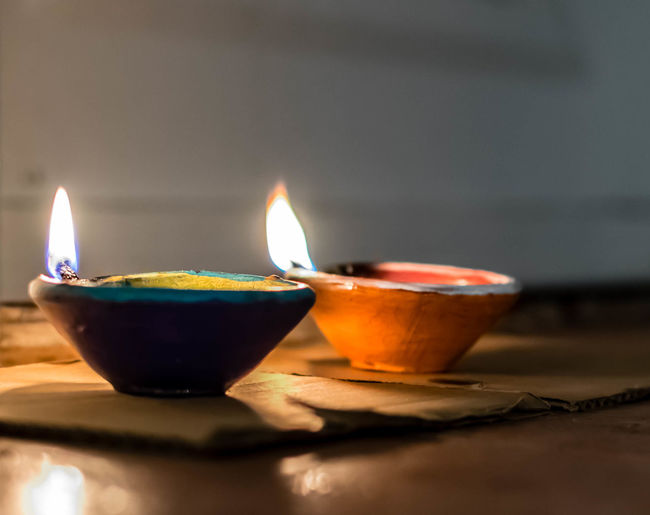 Lead kindly light Light Burning Candle Close-up Diwali Diya - Oil Lamp Electric Lamp Fire Fire - Natural Phenomenon Flame Glowing Heat - Temperature Illuminated Indoors  Light And Shadow Lighting Equipment Nature No People Oil Lamp Oil Lamps Selective Focus