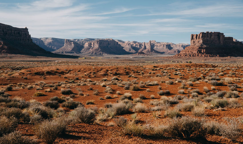 Red Rocks  Utah Utah Scenery Monument Valley Monument Valley,Utah USA Navajo Scenics - Nature Environment Landscape Mountain Sky Tranquil Scene Cloud - Sky Beauty In Nature Non-urban Scene Land Tranquility Nature Rock No People Rock Formation Mountain Range Physical Geography Arid Climate Outdoors Climate Semi-arid Formation Rock - Object Desert Plant