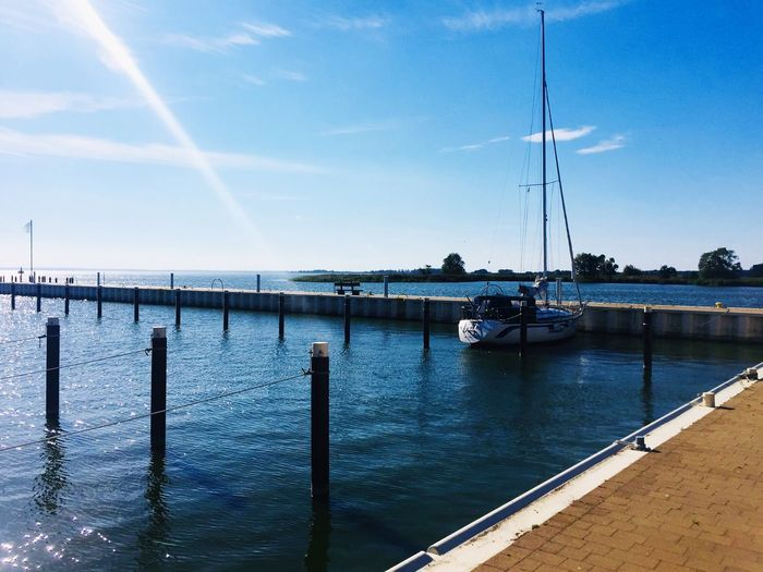 Achterwasser Water Sky Transportation Nautical Vessel Mode Of Transportation Nature Sea No People Connection Day Built Structure Architecture Blue Sailboat Beauty In Nature Sunlight Bridge Outdoors Marina