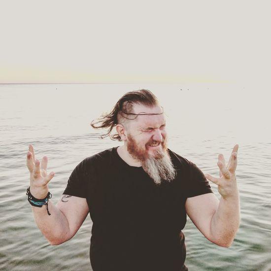 Portrait of man standing in water