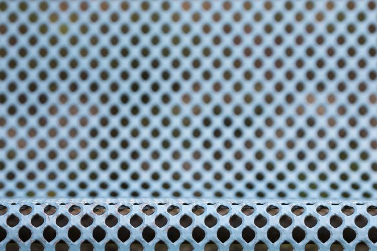 Full frame shot of blue metallic bench