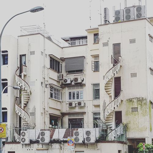 I love looking at Spiral Staircases and I love seeing these in shophouses but can I live in a home like this? Where I may open the door and see a stranger on my staircase? Probably not. Sg_architecture Architecture Shophouses  Singapore