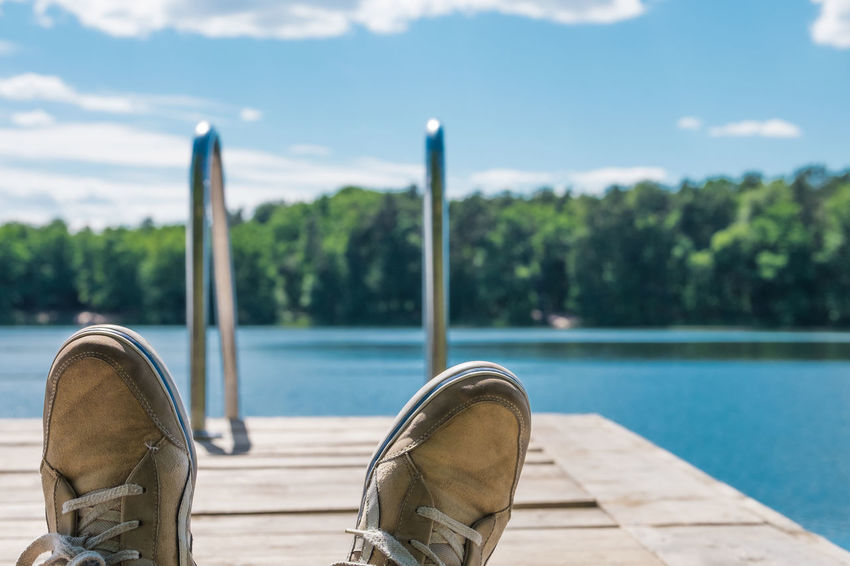 Chill out after an intense day // Beauty In Nature Blue Chillin Chilling Focus On Foreground Idyllic Jetty Lake Lake View Nature Outdoors Part Of Personal Perspective Relaxation Relaxing Scenics Shoes Sky Summer Summertime Sunny Swimming Tranquility Tree Wooden