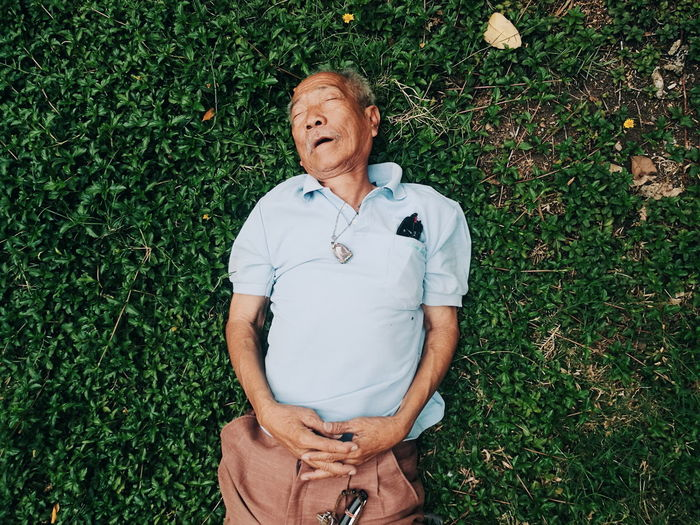 sleeping man People Street Outdoors Sleeping Close-up Grass Men Senior Adult Senior Men Grass This Is Masculinity