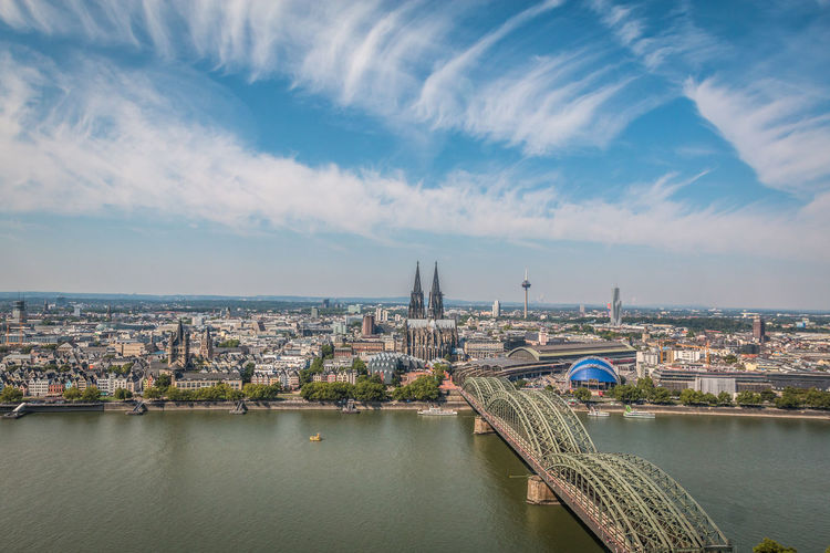 City of Cologne in Germany Cologne Cologne , Köln,  German Köln Kölner Dom Architecture Bridge Bridge - Man Made Structure Building Building Exterior Built Structure City Cityscape Cloud - Sky Cologne Cathedral Connection Day Nature No People Office Building Exterior Outdoors River Sky Skyscraper Transportation Travel Destinations Water