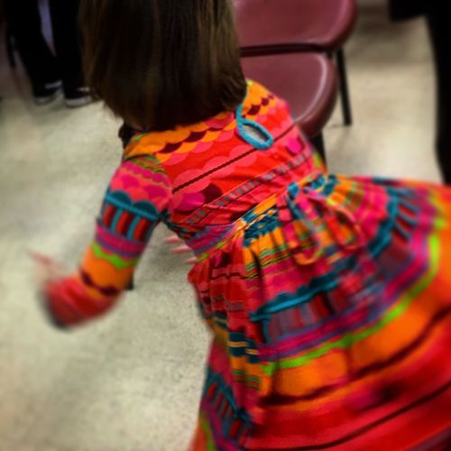 Rear view of boy standing against multi colored background