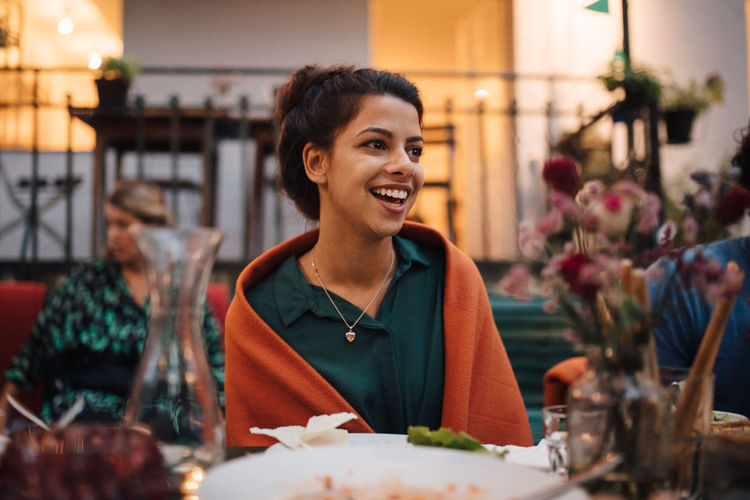 Portrait of a smiling young woman in restaurant