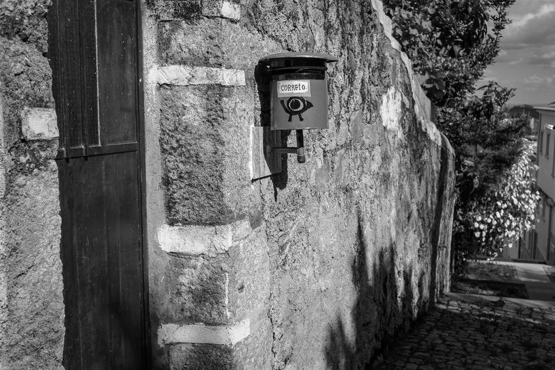 Write me a letter Architecture Clock Day Door Horizontal Monochrome Photography Nature No People Outdoors Postbox Stone Stone Wall Tree