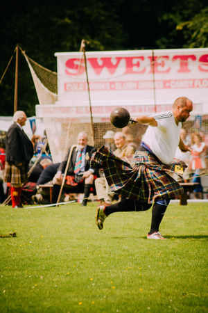 Events Fun Highland Games Kilt Leisure Activity Lifestyles Real People Scotland Sport Sports Sports Photography Throwing  Tradition Weight
