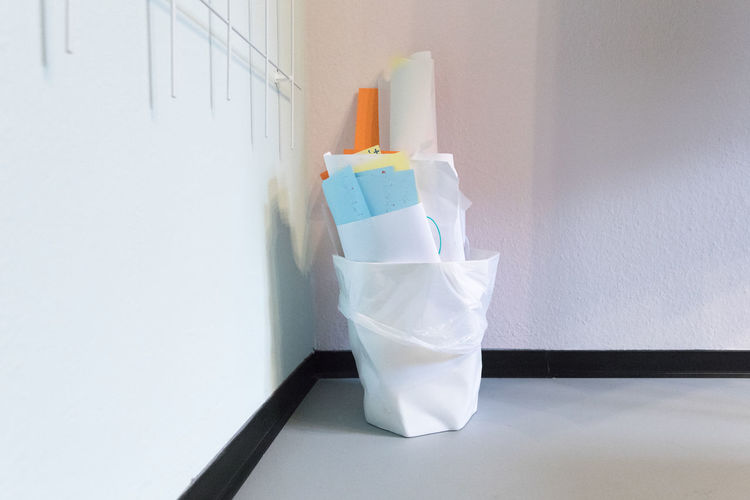 Workshop outcome (flipchart paper) in a paper bin Business Decisions Flipchart Meeting Office Workshop Close-up Corner Failure  Frustration Full Garbage Ideas Indoors  Inspiration Large Group Of Objects Overflowing Paper Place Of Work Problems Rejection Side View Still Life Wastepaper Basket White Color