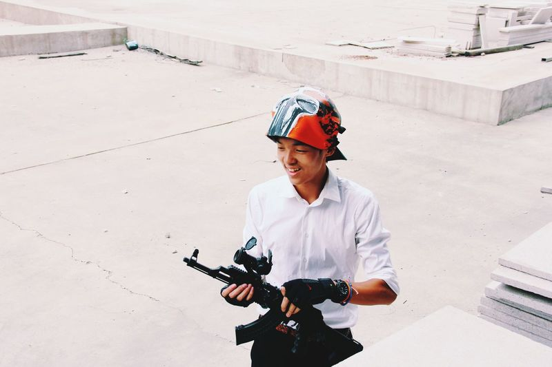 The Enforcer Justin High Angle View Real People Outdoors Technology Headwear People Mask War AK47 Gun Check This Out Vscocam VSCO China Best EyeEm Shot Teenager Architecture Streetphotography Standing