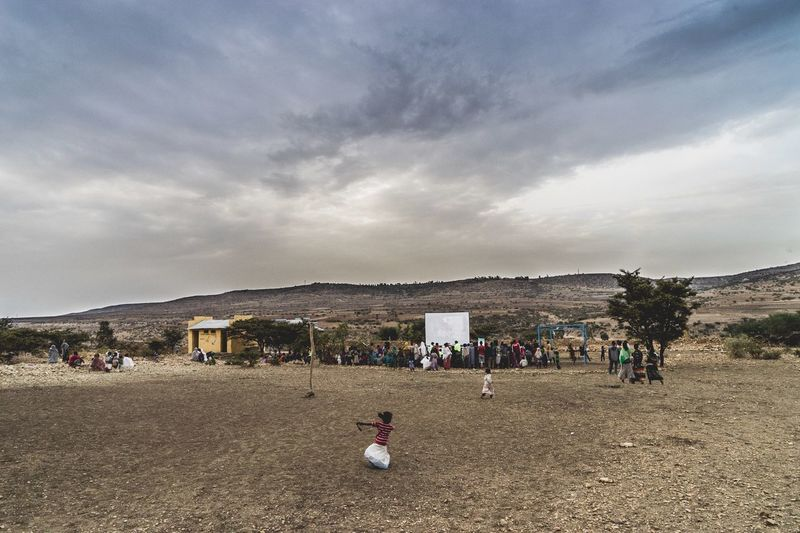 Cinema In Your Life Children see a movie for the first time in their lives through this mobile cinema project. Cinema is not just entertainment but something that brings the community together; it allows children to be children. Ethiopia Travel Streetphotography Life Sonya7II Street Photography Wanderlust Traveling Travel Photography Children Cinema Paradiso Mobile Cinema Landscape Street People Photography Eyem Best Shots Children Photography Rural Scenes Naturelovers Eye4photography  Photojournalism Photography Photo Photooftheday